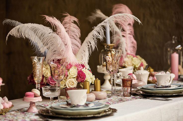 Think: Feathers, pastel colours, Fleur de lis crockery and floral prints.