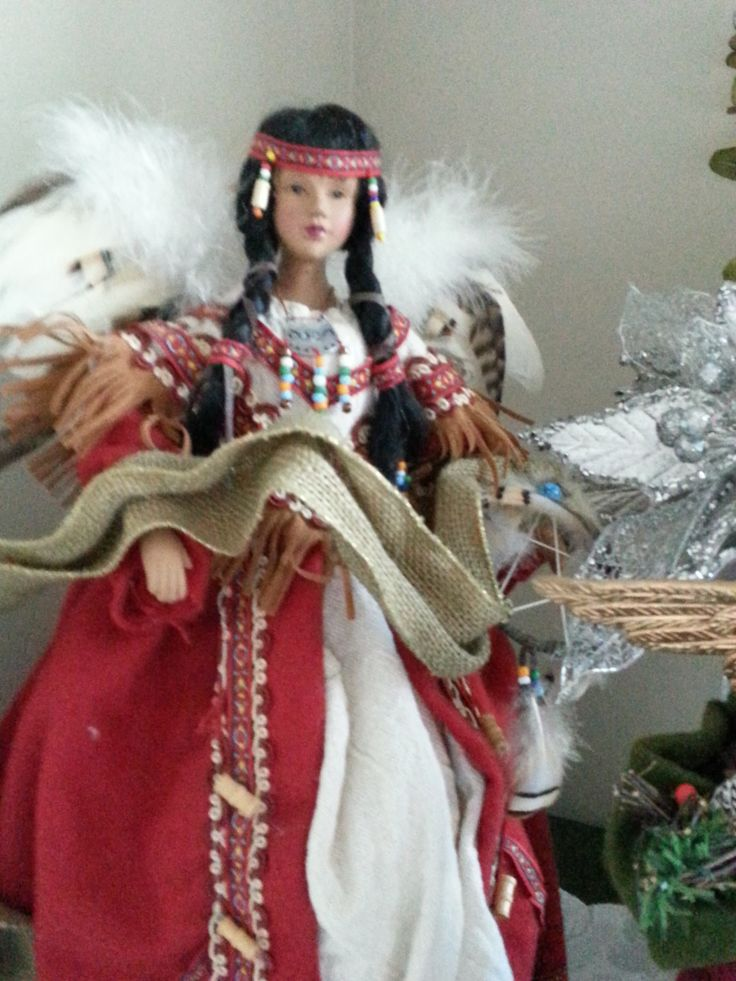 My Native American Christmas angel. Her wings are feathers and her gown of felt and burlap is heavily beaded. She's gorgeous. www.christinelindsay.org