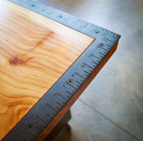Mount a builders square to the corner of your work station for measuring. Or use a builders industrial metal ruler, like a 4' one.