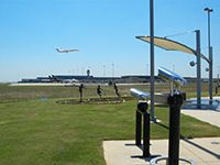 Watch airplanes take off at Founders' Plaza at DFW