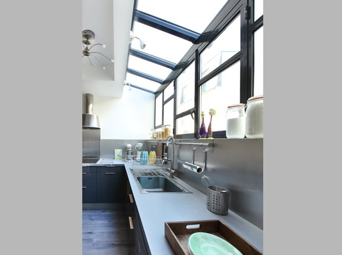 kitchen or bath could go on a balcony at the backside of the house