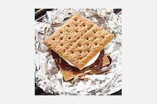 Easy Grilled S'mores--Traditional s'more ingredients are assembled then wrapped in foil and grilled for a quick and easy way to serve this favorite kids campfire treat.