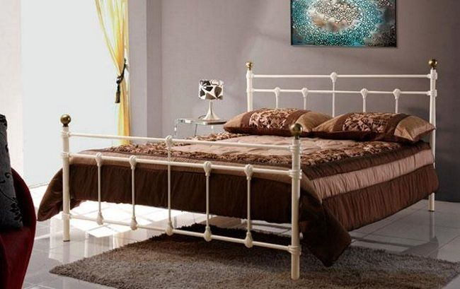 4ft6 Alana Cream Bed Frame - £199.95 - Steel framed construction with a sprung slatted base. The sprung slats are good quality and provide a nice sprung feel to the mattress you choose to add to this bed. The finials on the head and footend are a brass colour for a classy finish! Easy self assembly with an allen key which is included.