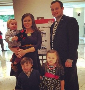 Josh and Anna Duggar with children and expecting baby number four - it's a girl!