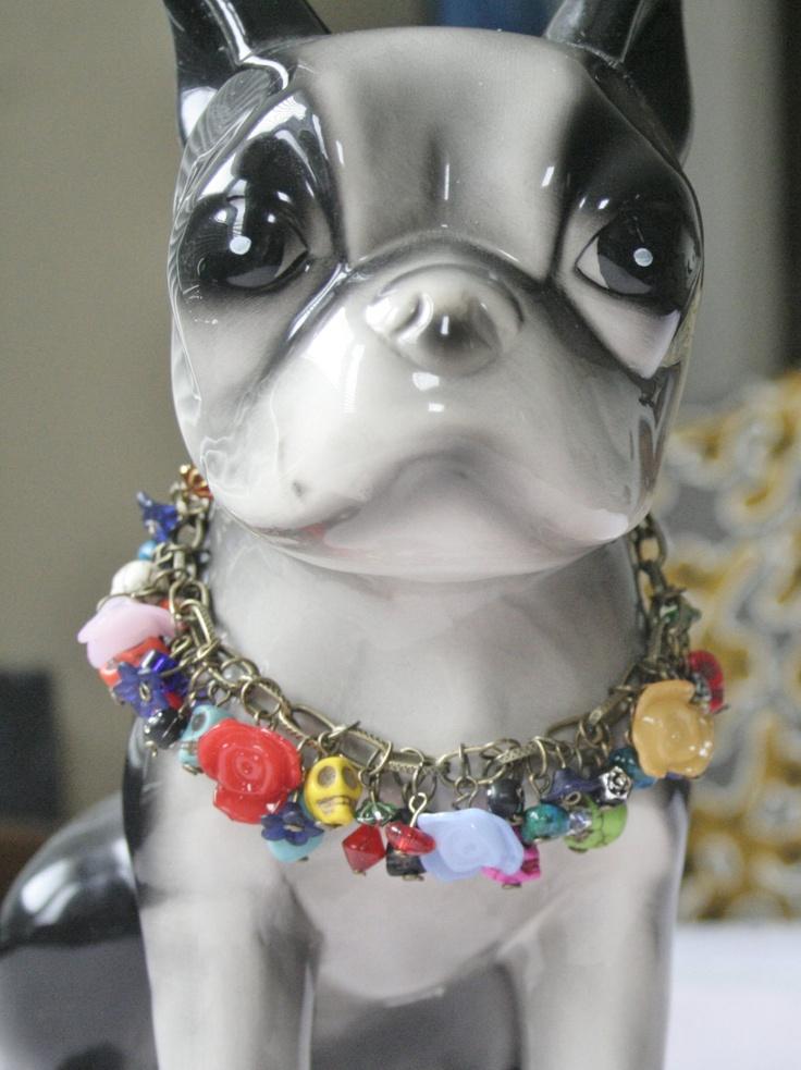 OOAK Skull Charm Bracelet / Day of the Dead Charm Bracelet / Skull and Flowers Brass Charm Bracelet. $29.95, via Etsy.