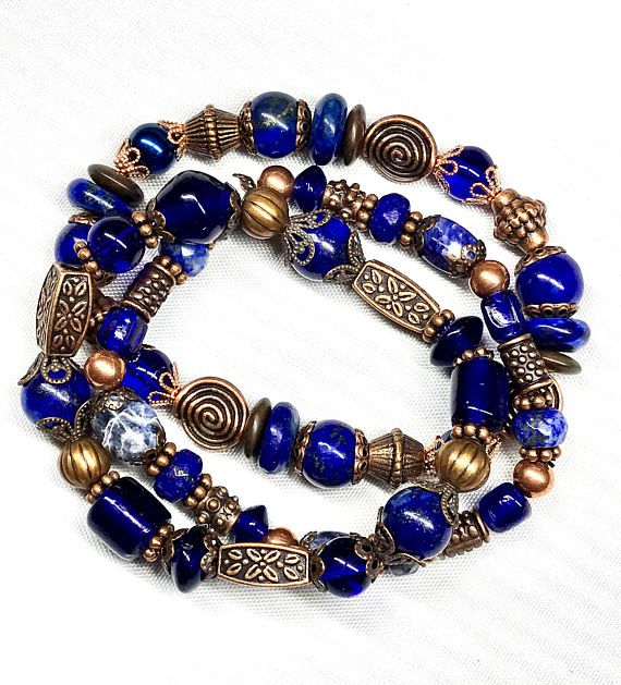 Set of three beautiful Navy & Copper stretchy beaded bands....Wear one, two, or all three! These bracelets are chocked full of beads... I used a combination (various sizes & shapes) of Lapis Lazuli Beads, Sodalite Beads, Cobalt Blue Druk Beads, and many various Copper Beads, Bead Caps & Spacers. These bracelets are so comfortable and easy to use! LAPIS LAZULI: Has been valued through the ages as a link to the all-knowing sources of knowledge and for invoking wisdom. Traditionally ...