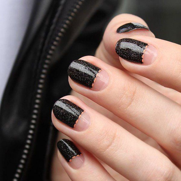 Instead of giving color to the lower part, why not leave it with only a transparent protective coating? It will look unique. Then use a black with glitters on the other parts and just some orange thin lines where the nail and the nail polish meets.