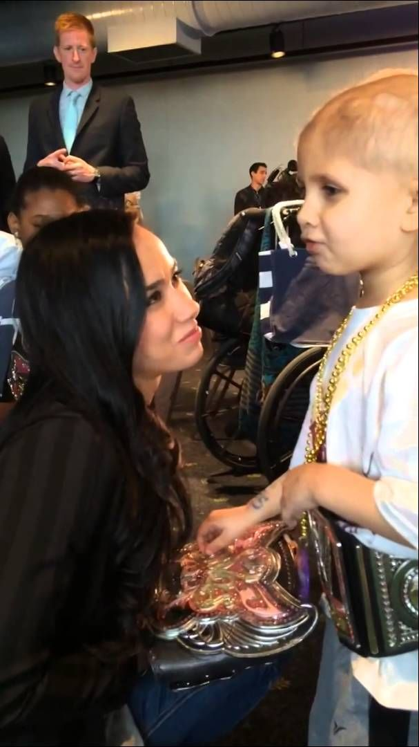 Warrior Award recipient Connor The Crusher meets AJ Lee. R.I.P. Connor <3