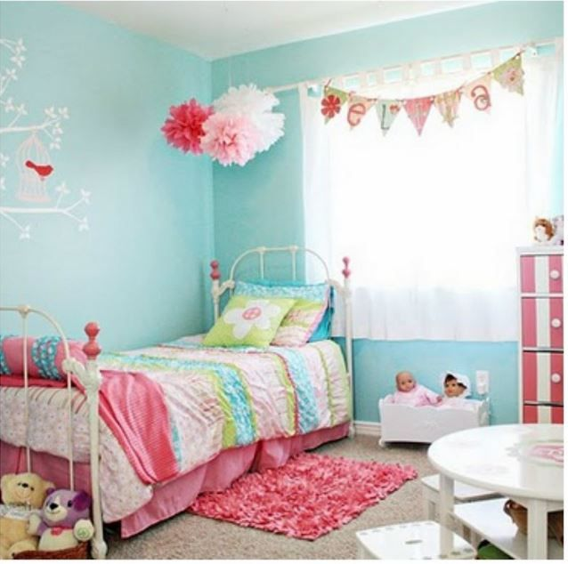 So cute! I like the shade of blue on the walls. Goes well with all the pinks. bunting and poms