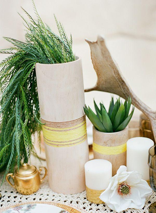 yarn-wrapped centerpieces and greenery, photo by Clayton Austin http://ruffledblog.com/southwestern-desert-wedding-ideas #centerpieces #weddinginspiration #reception
