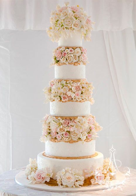 gorgeous flower-stuffed tall wedding cake by Ana Parzych Cakes
