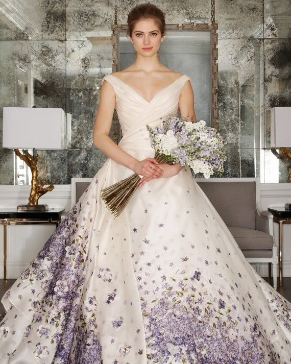 This pearl- and French violet-printed silk organza ball gown is seriously fit for a princess. Plus, we can't get enough of that draped off-the-shoulder bodice.