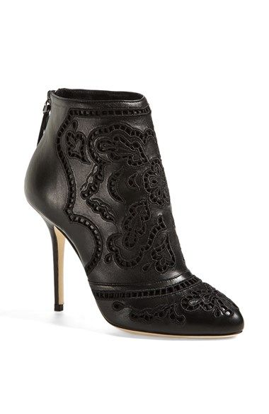 Free shipping and returns on Dolce&Gabbana Laser Cut Bootie at Nordstrom.com. Dolce&Gabbana strike a balance of sensuous allure and intricate femininity with this lithe leather bootie. Embroidered eyelet cutouts create a lacy look that's kept edgy with a blackout palette and sleek silhouette.