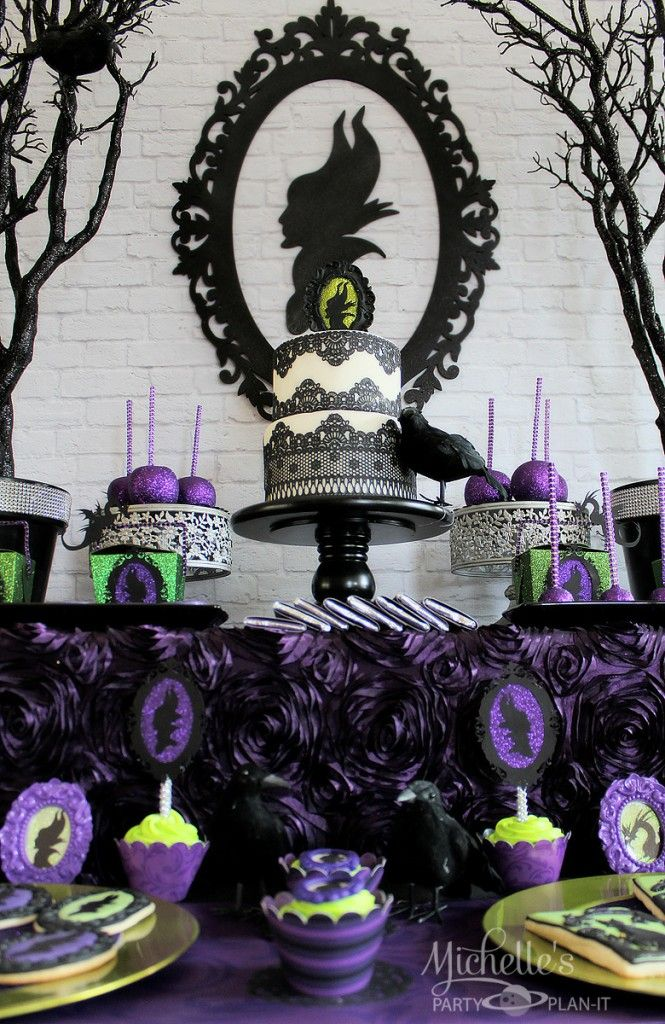 Black, green and purple villains inspired dessert table. Love this for a villains party.
