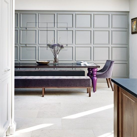 Purple is the perfect partner for this pale shade of grey, with the wooden accents injecting warmth and richness.