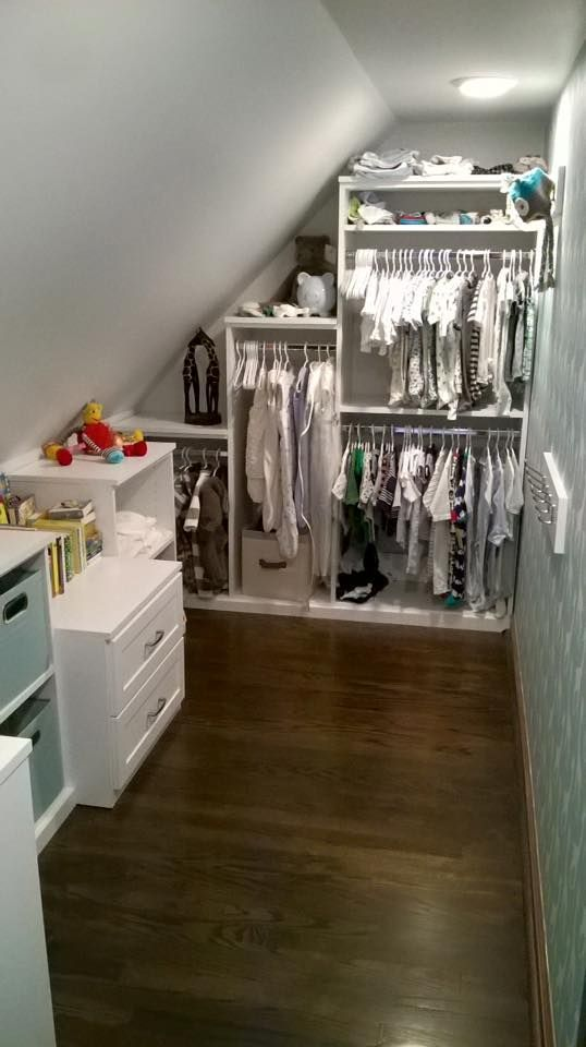 Walk In Attic Closet Features A Sloped Ceiling Lined Past Rustic Wood Beams Higher Than Angled Built Shoe Cubbies And Sweater Shelves Neighboring To