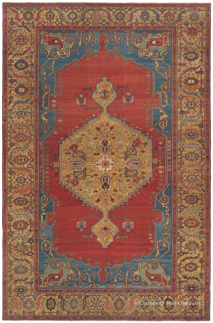 Serapi, 9ft 3in x 14ft 6in, 3rd Quarter, 19th Century.  An unexpected wealth of rare saffron gold dye in its expansive center medallion and border immediately distinguish this magnificent antique Serapi Persian carpet. Dramatic horizontal abrash (intentional color striation) crisscrosses the open, watermelon hued field as well as the shimmering marine blue corners and glorious border, creating a sense of great dimensionality.