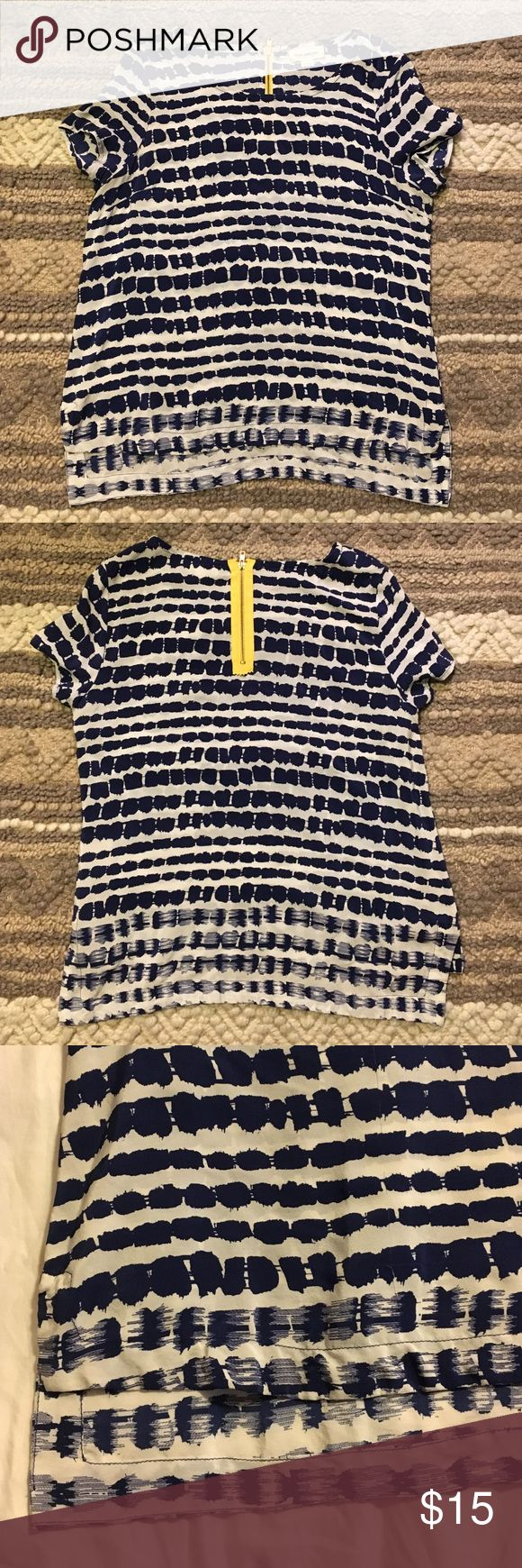 Patterned silk short sleeve top Originally purchased from Anthropologie, this top is 100% silk and features a fun, blue and white pattern with a bright yellow zipped in the back. The top is staggered so the back is roughly 3 inches longer. fynn and rose Tops Blouses