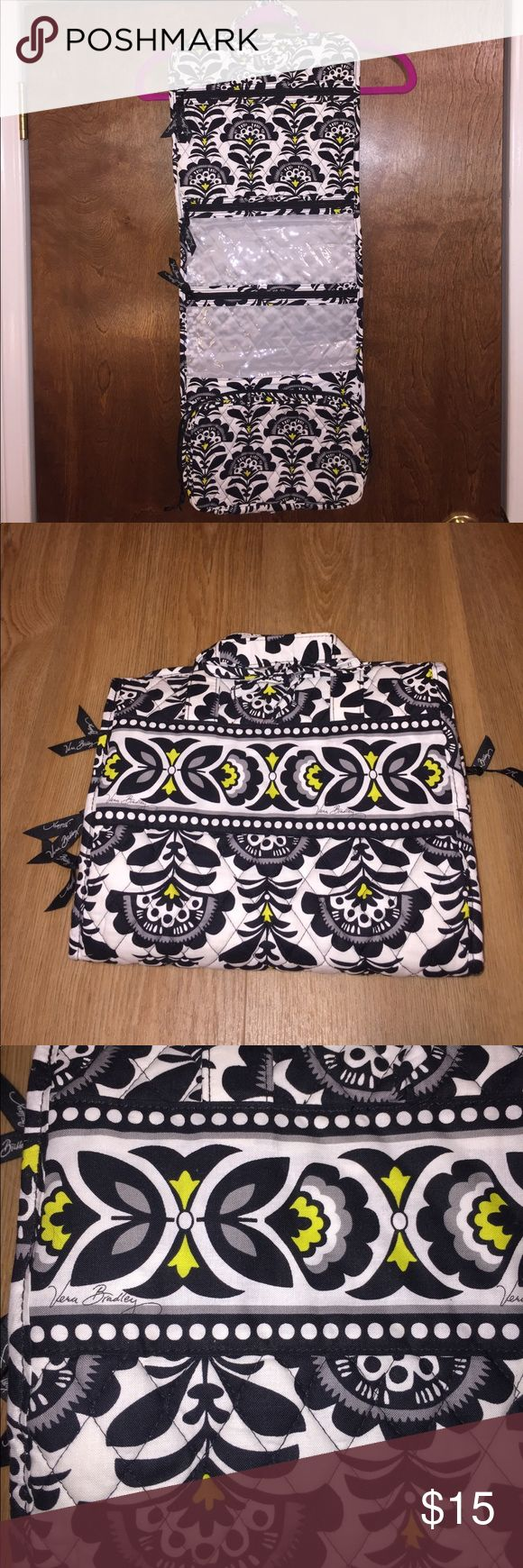 Vera Bradley travel organizer Like new Vera Bradley hanging travel organizer. 4 zipper compartments to store jewelry, hair accessories, makeup and whatever else you don't want to lose. Vera Bradley Bags