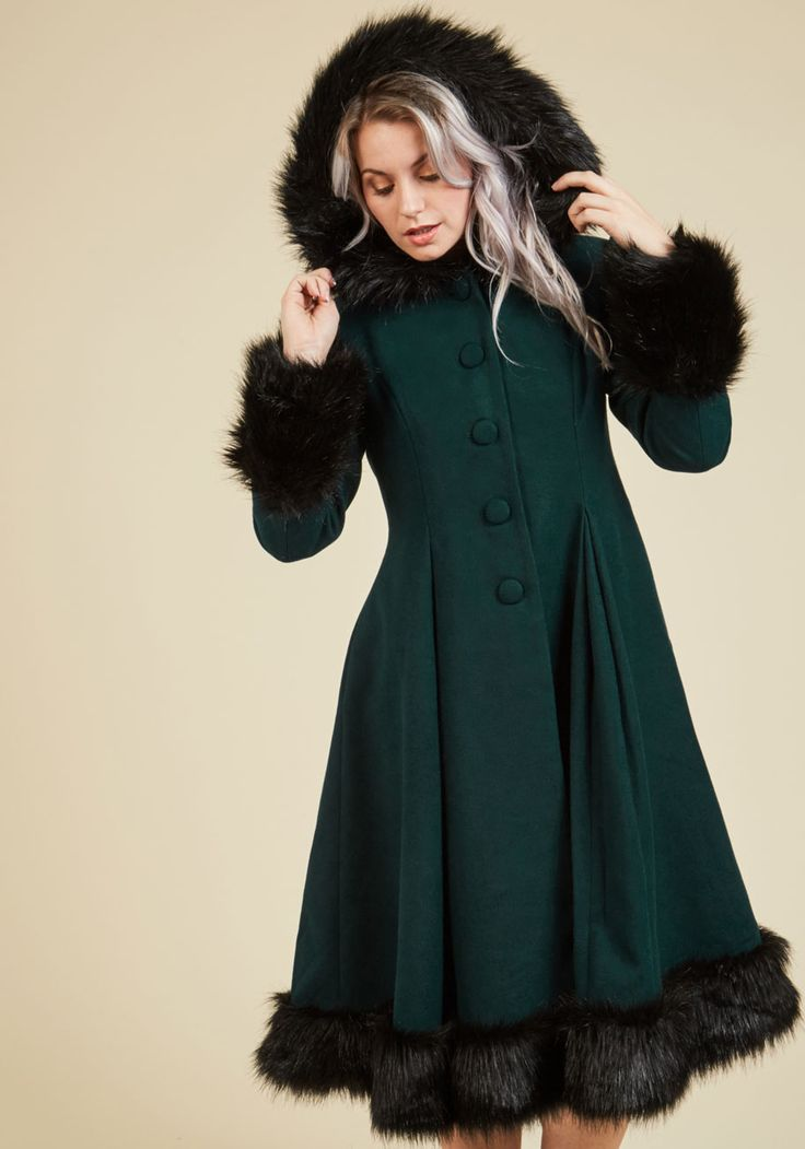 Northeast Nobility Coat | Mod Retro Vintage Coats | ModCloth.com The landscape of snowdrifts and icicles is your kingdom, which you rule with this dark green coat's stylish sophistication. Detailed with puffed shoulders, pockets, and black faux fur around its warm hood, sleeve cuffs, and dressy hemline, this buttoned A-line deems you queen of the winter scene!