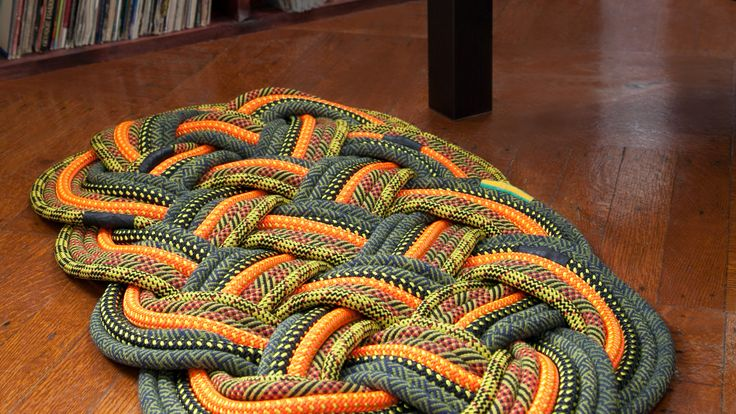 Gorgeous mat/rug made from sailing rope.  Wonder if I could do something like this with braided fabric?