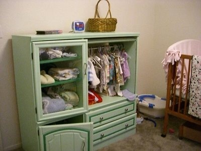 Repurpose an entertainment center into a nursery wardrobe. This would solve my problem of the nursery having no closet.