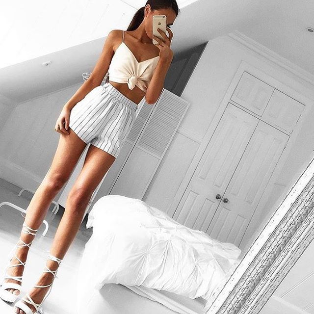 Beige Tie Up Crop | #SaboSkirt  Our newest babe has legs for days! @em.spiliopoulos