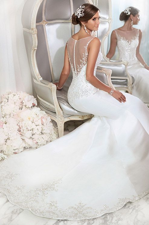 Ivy beading on the high illusion neckline and back give this wedding dress its European appeal. Essense of Australia, Fall 2014