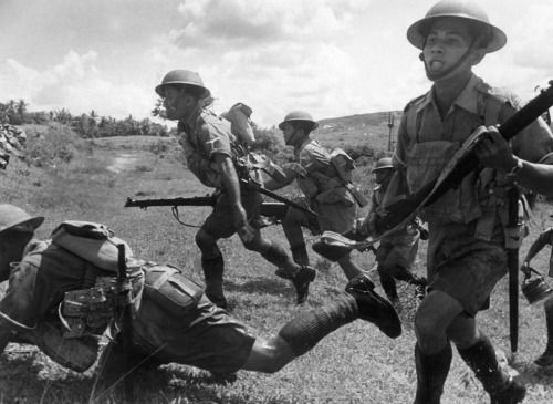 Malayan soldiers photographed charging forward at a Malay battle zone in February 1942, before the Japanese completed their occupation of the peninsula and pushed Britons back onto Singapore Island.
