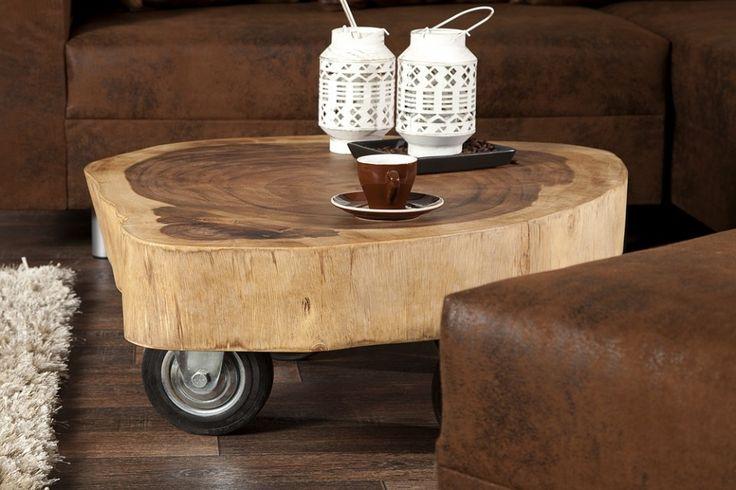 Salontafel / Bijzettafel. Super handig op wieltjes. staat prachtig in het midden . De bonte bank en stoelen erom heen.