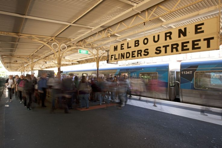 """The station sign on Platform 11 declares """"Melbourne Flinders Street"""" - for the benefit of passengers arriving from Port Melbourne and the ships docked there."""