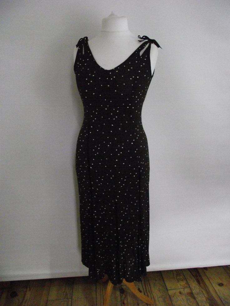 Vintage 90s Evelin Brandt of Berlin slip dress in chocolate brown with cream spots and cute little ties to the shoulders, drapes the body beautifully and flares out at the hemline.  Measurements are approximate and are taken laid flat, seam to seam, not on a model (Bust/chest/hip/waist are then doubled), please remember to leave yourself a little wiggle room.  Condition: Excellent - Ready to wear Modern Size Estimate: small - EU 36 UK 8/10 Mannequin Size: UK 12 Label: Evel...