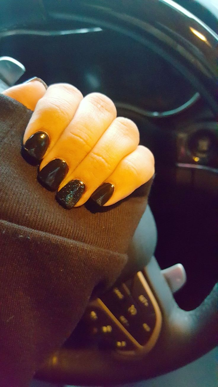 black short square acrylic nails for new years black and glitter tan hands