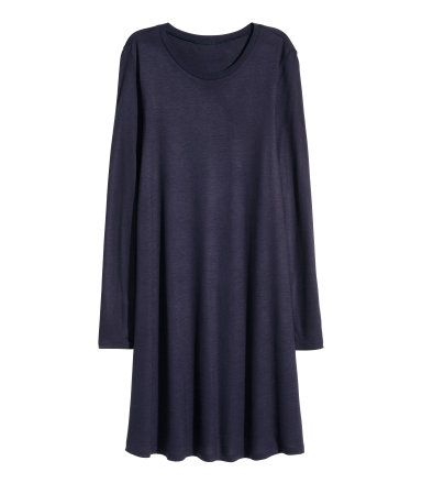 Dark blue. Short dress in soft jersey with long sleeves and a gently flared skirt.