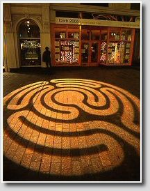 Right & below: Labyrinth of light, projected onto the pavement outside the Cork 2005 Information office in St. Patrick Street.    Labyrinth Projections designed by Jeff Saward.