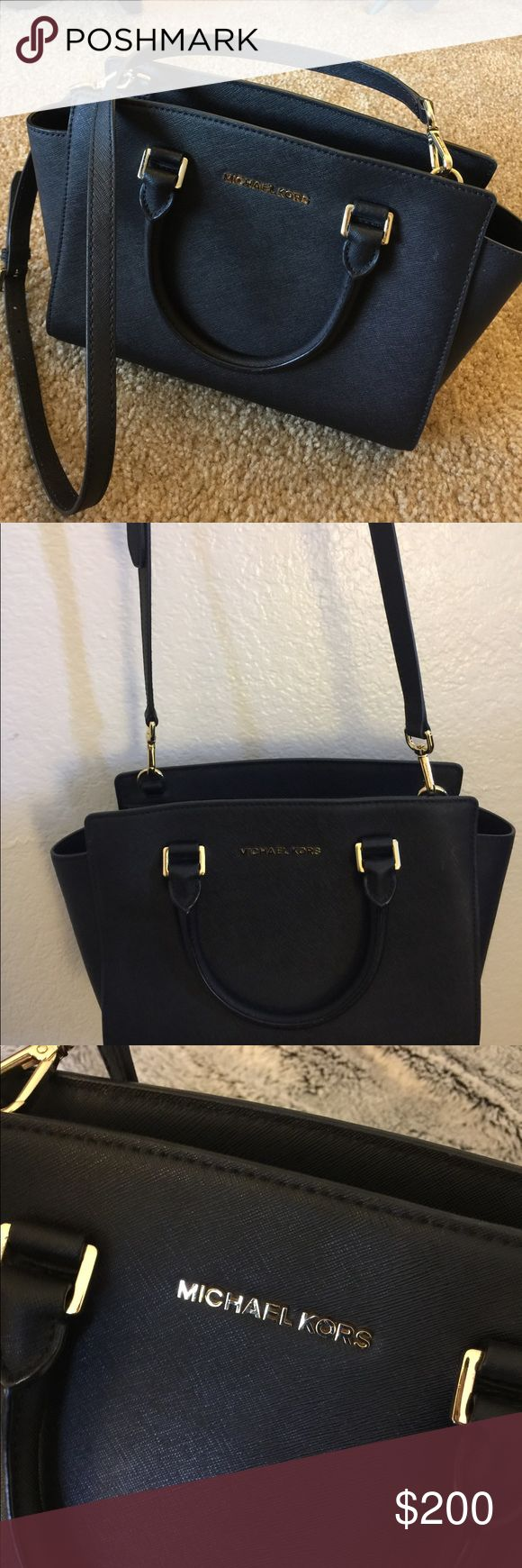 Michael Kors Designer black shoulder bag Michael Kors black shoulder back. Adjustable and detachable strap. Michael Kors logo in Gold. Only worn twice. Great condition. 2 inside compartment pockets and one zipper pocket also inside strap with hook. Can easily turn into bucket bag. Like new Michael Kors Bags Satchels