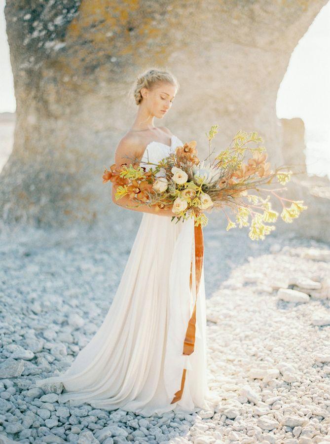 Overflowing autumn inspired wedding bouquet: http://www.stylemepretty.com/destination-weddings/2016/11/10/faro-inspired-wedding-shoot/ Photography: 2 Brides - http://2brides.se/