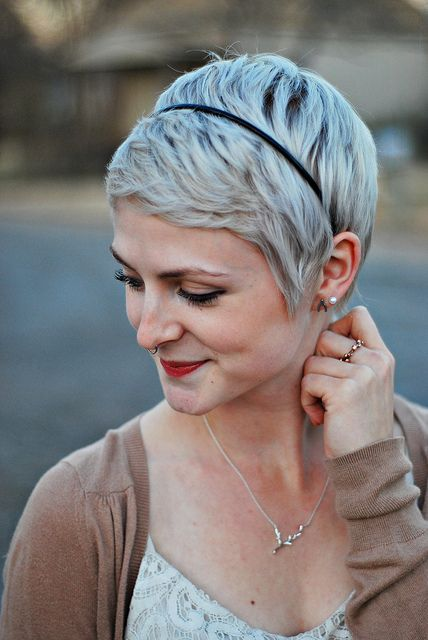pixie cut with headband and septum piercing