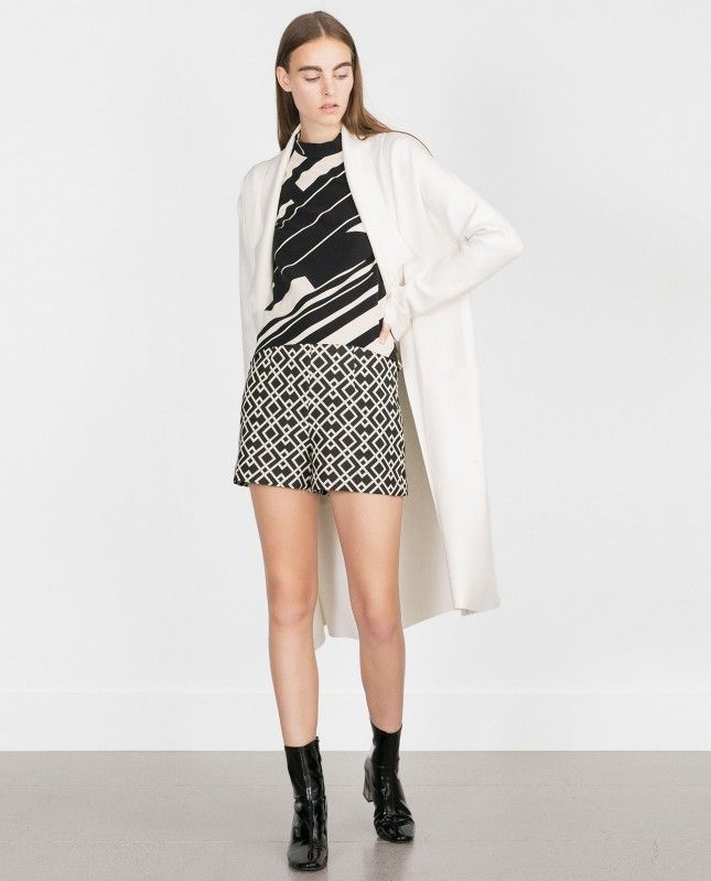Pair up shorts with over-the-knee stockings or woolen tights this winter.