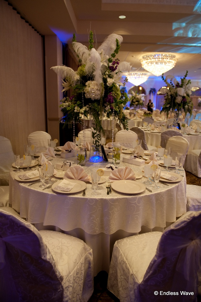 Unique Centerpiece With Flowers Feathers And Jewels At The Versailles Ballroom Located Inside Ramada Toms RiverUnique