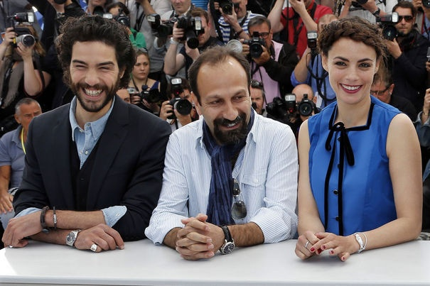 Director Asghar Farhadi poses with cast members Tahar Rahim and Berenice Bejo during a photocall for the film 'Le Passe' at the 66th Cannes Film Festival