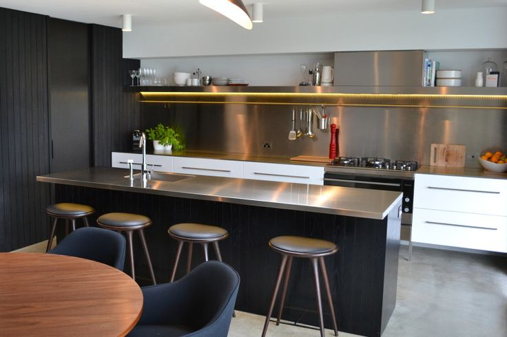 Stainless steel island benchtop and full wall length splashback, with cleverly hidden rangehood