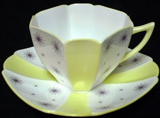 """Eric Slater was the son of Walter Slater, Art Director at Shelley potteries, and English China manufacturer. In 1919 Eric Slater joined Shelley to create new styles of china . His first major success at the company was with the """"Queen Anne"""" china design. The Queen Anne (pictured) featured an 8 sided shape that resembled a geometric flower. ART DECO -- Circa 1930:"""
