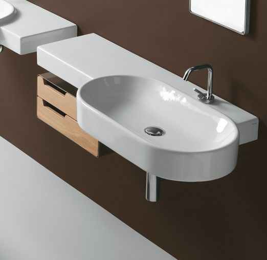 FL22 | Flow Ceramica Simas Oval wall hung washbasin 113 with left shelf pre-punched for single tap hole.