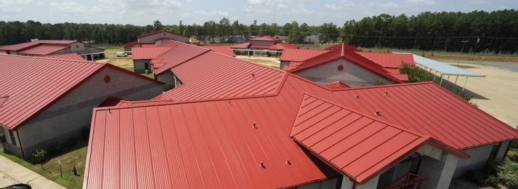 This metal roof reminds be a of an old barn. It would be fun to have a colorful roof like this one on a farmhouse. That way it would look like a barn, but it would be a modern take on it. Also the metal looks like it would protect your house from the elements really well.