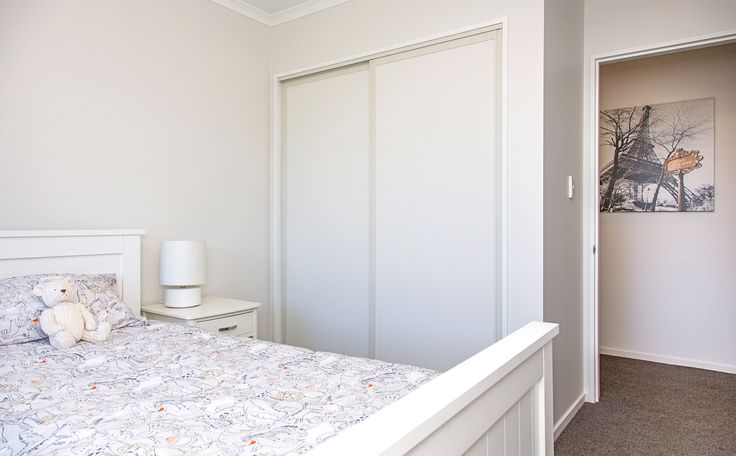 Create extra storage with built in wardrobes.