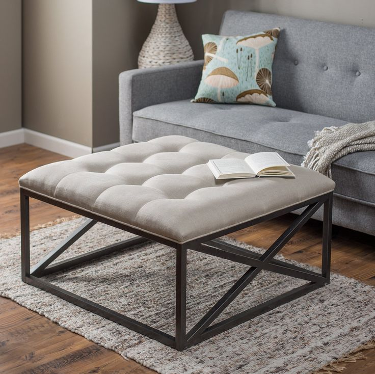 Sleek modern open designed style linen tufted coffee table ottoman.