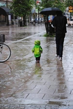 Walking in the rain. Father and son.