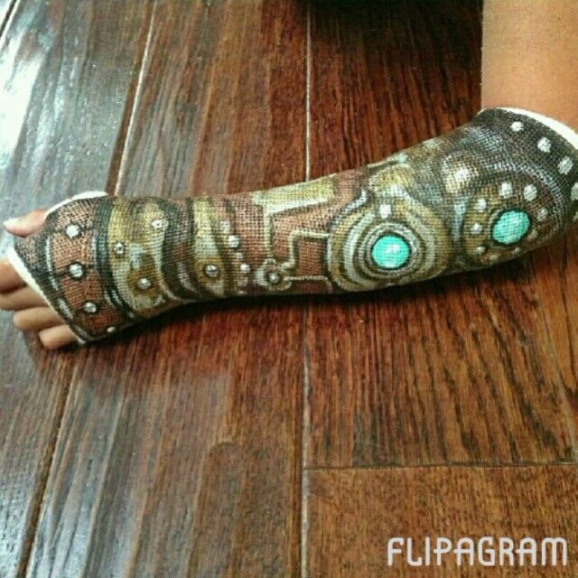 Painted Casts | Steampunk inspired robotic arm painted cast by Katie Gaines of Love Paper Paint with Modern Masters Metallic Paint.
