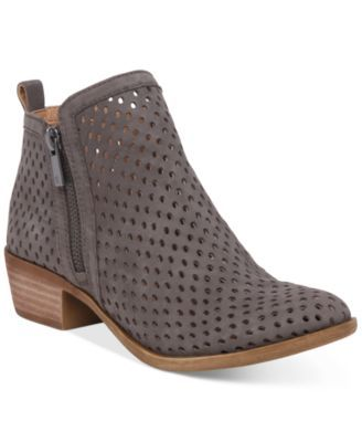 Perforated details bring a contemporary update to these Basel booties from Lucky Brand for a cool look any time of day. | Leather upper; manmade sole | Imported | Almond closed-toe booties | Zipper cl